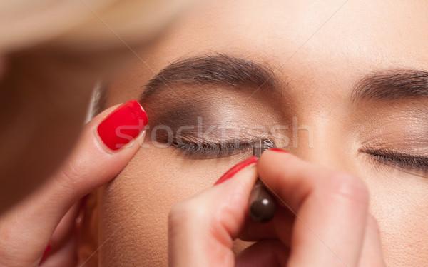 Model having eye makeup applied Stock photo © stryjek
