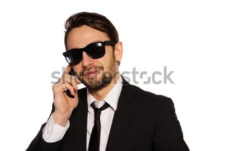 Smiling businessman in sunglasses on his mobile Stock photo © stryjek