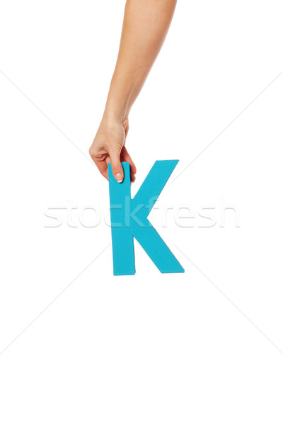 hand holding up the letter K from the top Stock photo © stryjek