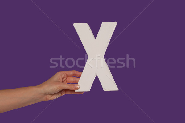 Female hand holding up the letter X from the left Stock photo © stryjek