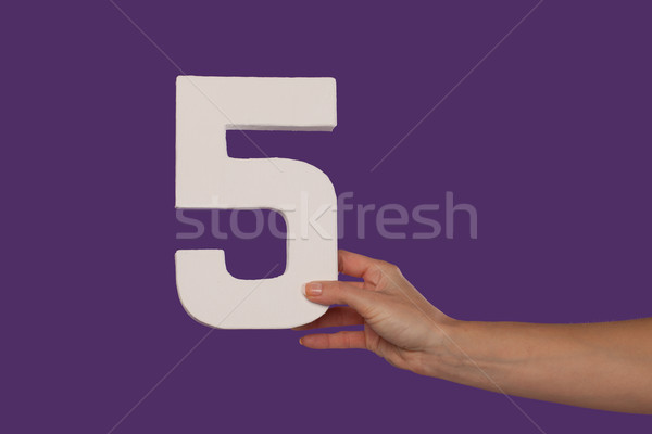 Female hand holding up the number 5 from the right Stock photo © stryjek