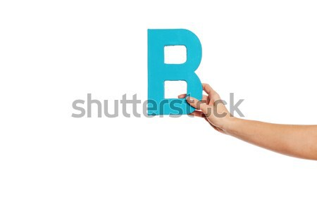 hand holding up the letter B from the right Stock photo © stryjek