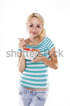 Young beautiful woman eating corn flakes  Stock photo © stryjek