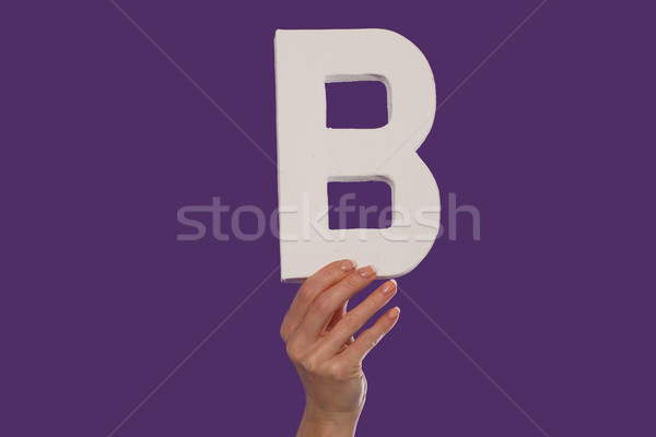 Female hand holding up the letter B from the bottom Stock photo © stryjek