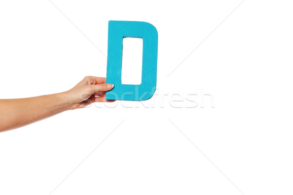 hand holding up the letter D from the left Stock photo © stryjek