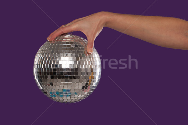 Female hand holding a disco ball Stock photo © stryjek