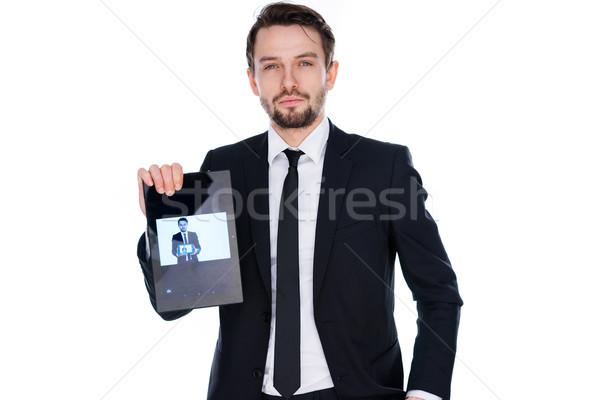 Man displaying a handheld tablet computer Stock photo © stryjek