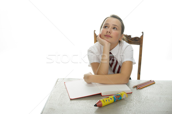 Сток-фото: скучно · молодые · школьница · сидят · столе