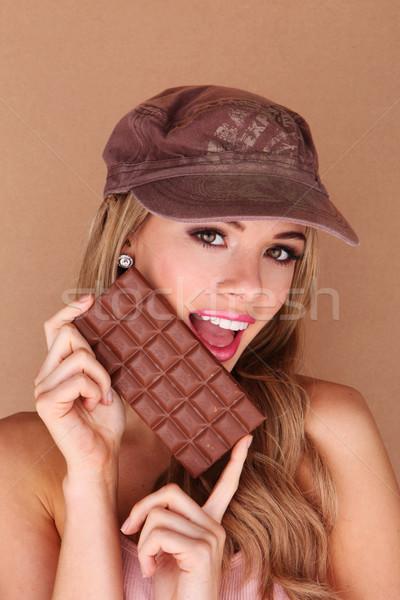 Laughing Woman Holding Chocolate Stock photo © stryjek