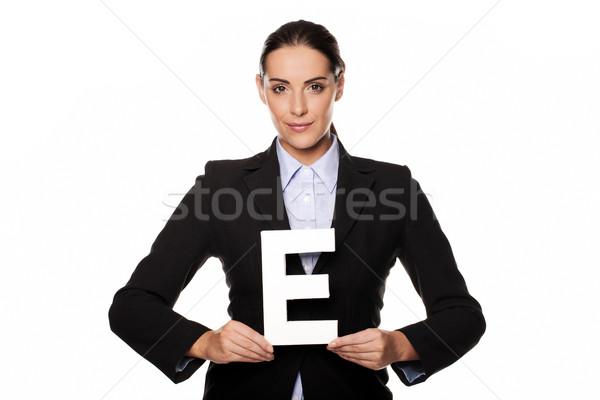 Businesswoman holding a capital letter E Stock photo © stryjek