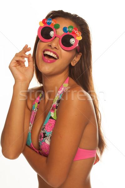 Stock photo: girl celebrating wearing birthday sunglasses on white