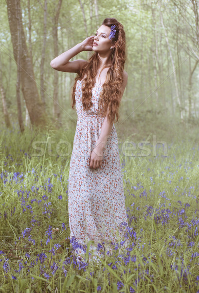 Artistic portrait of a girl in a bluebell forest Stock photo © stryjek