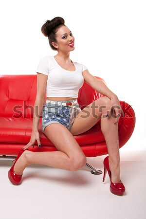 Retro Pin-up Girl On Red Leather Couch Stock photo © stryjek