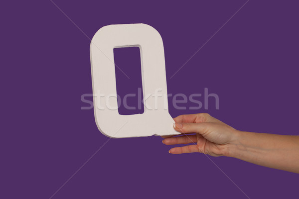 Female hand holding up the letter Q from the right Stock photo © stryjek
