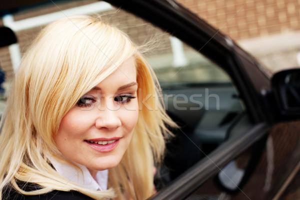Woman driver reversing her car Stock photo © stryjek