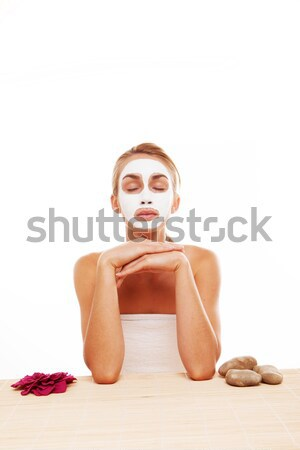 Woman sitting in a face mask Stock photo © stryjek