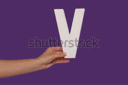 Female hand holding up the letter V from the right Stock photo © stryjek