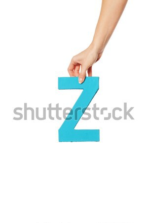 hand holding up the letter from the top Stock photo © stryjek