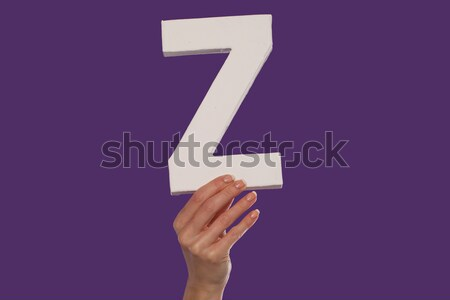 Female hand holding up the letter Z from the right Stock photo © stryjek
