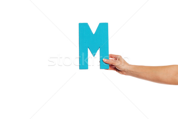 hand holding up the letter M from the right Stock photo © stryjek