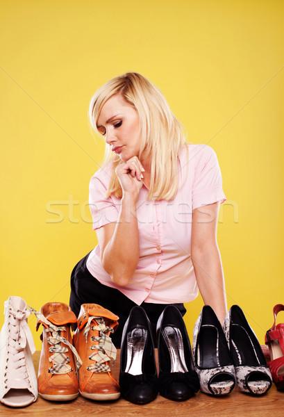 Vonzó szőke nő választ cipők szőke nő áll Stock fotó © stryjek