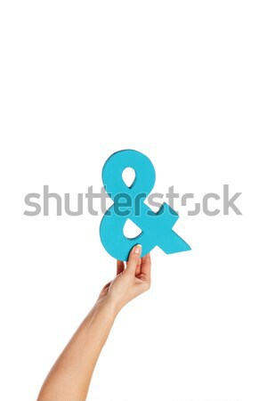 hand holding up an ampersand from the bottom Stock photo © stryjek