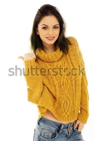 Trendy young woman giving a thumbs up Stock photo © stryjek