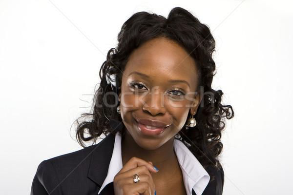 solated studio shot of a smiling businesswoman  Stock photo © stryjek