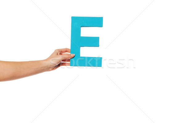 hand holding up the letter E from the left Stock photo © stryjek