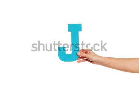 hand holding up the letter J from the left Stock photo © stryjek