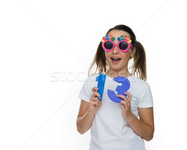 Happy young girl celebrating being a teenager Stock photo © stryjek