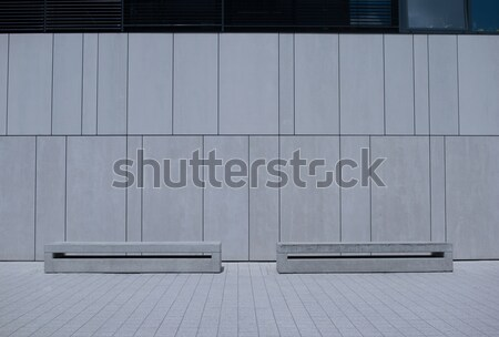 Two Similar Benches Against White Building Wall Stock photo © stryjek