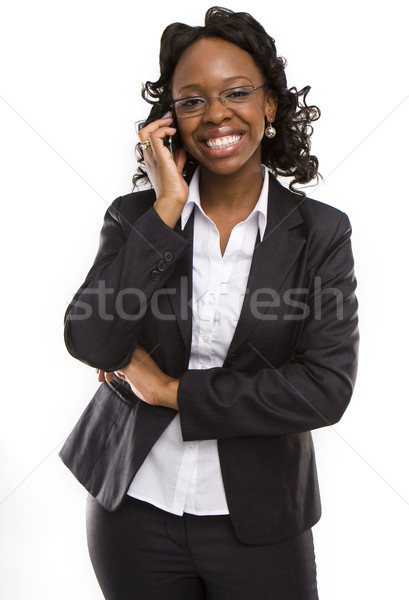 attractive young business woman calling by cellular phone. Stock photo © stryjek