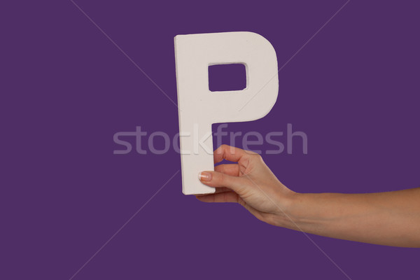 Female hand holding up the letter P from the right Stock photo © stryjek