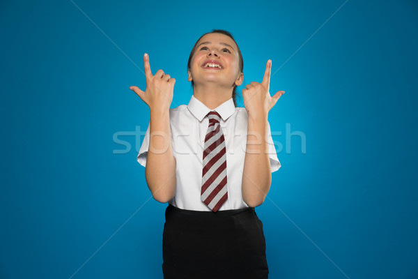 Happy young girl pointing above her head Stock photo © stryjek