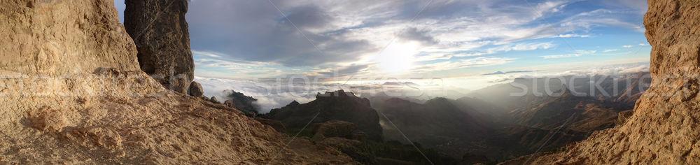 View through mountain cliffs of the sunrise Stock photo © stryjek