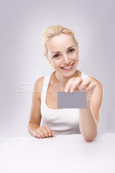 young blond woman with business card in hand  Stock photo © stryjek