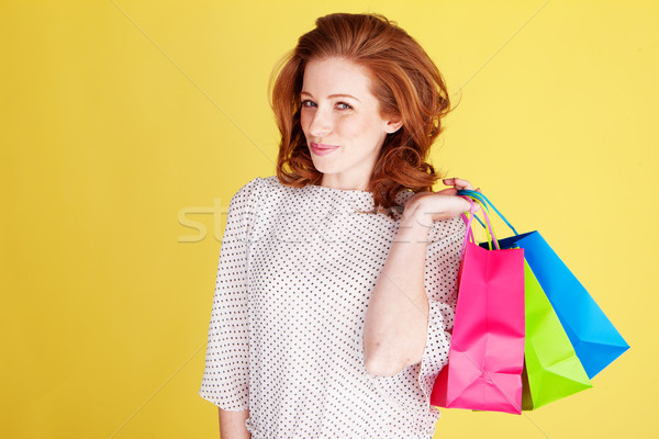 Teasing Woman With Colourful Bags Stock photo © stryjek