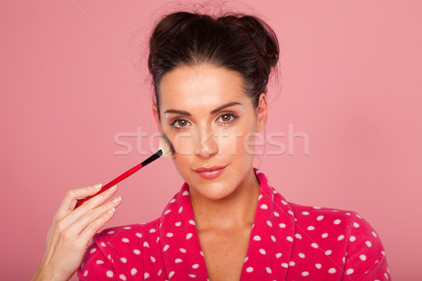Glamorous woman applying blusher Stock photo © stryjek