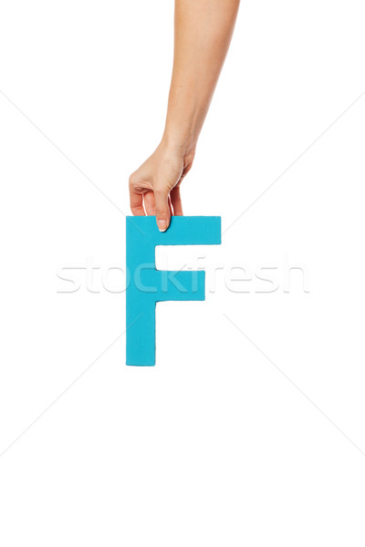 hand holding up the letter F from the top Stock photo © stryjek