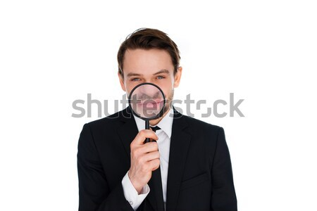 Businessman with a magnified smile Stock photo © stryjek
