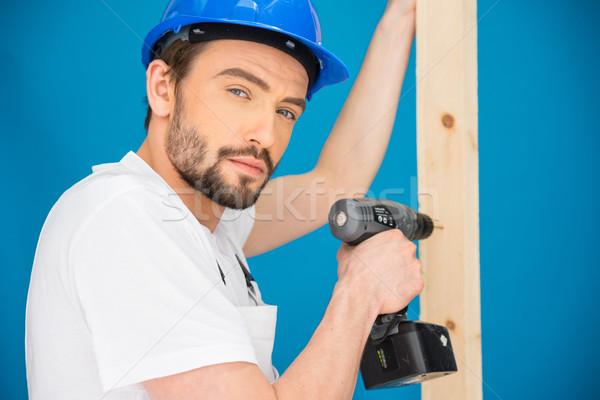 Foto stock: Carpinteiro · perfuração · buraco · madeira · construtor