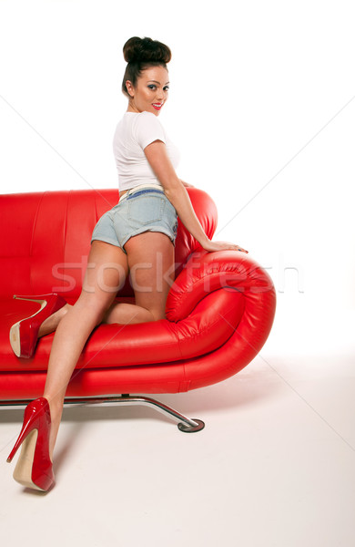 Pert Pinup Girl On Red Sofa Stock photo © stryjek