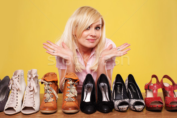Pretty blonde undecided on which shoes to wear Stock photo © stryjek