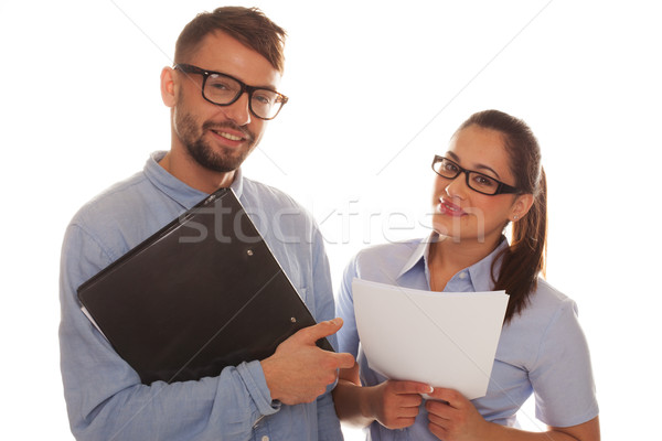 Nerdy couple holding files in a white background Stock photo © stryjek