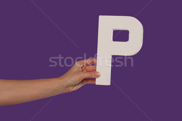 Female hand holding up the letter P from the left Stock photo © stryjek