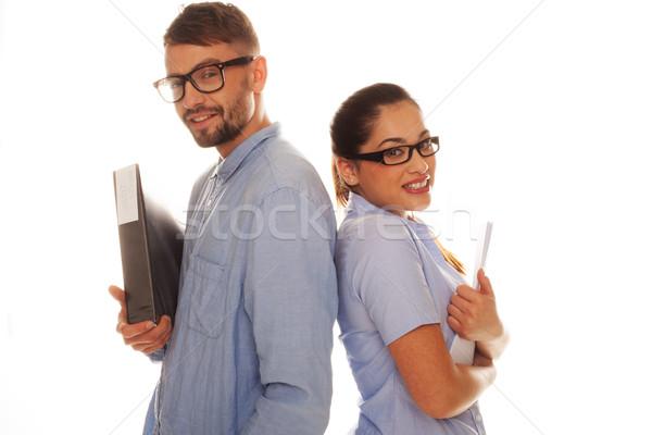 Nerdy couple holding files in a white background Stock photo © stryjek