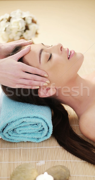 Young woman having a head massage in a spa Stock photo © stryjek