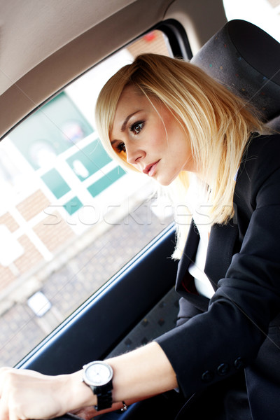 Beautiful businesswoman driving a car Stock photo © stryjek