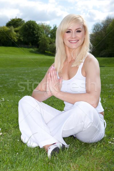 Smiling woman in yoga pose Stock photo © stryjek
